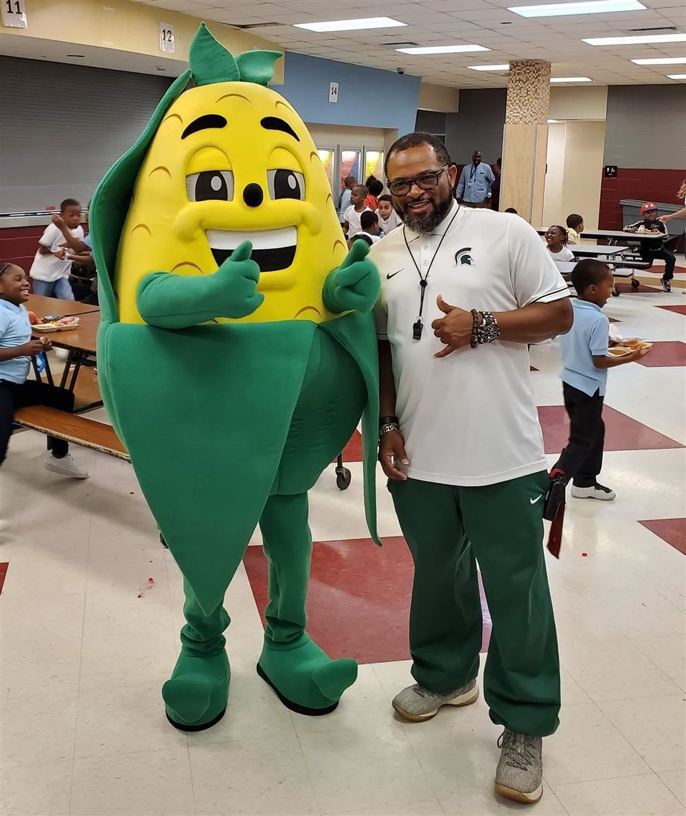 Coach Carson with the Fall Harvest Festival Mascot