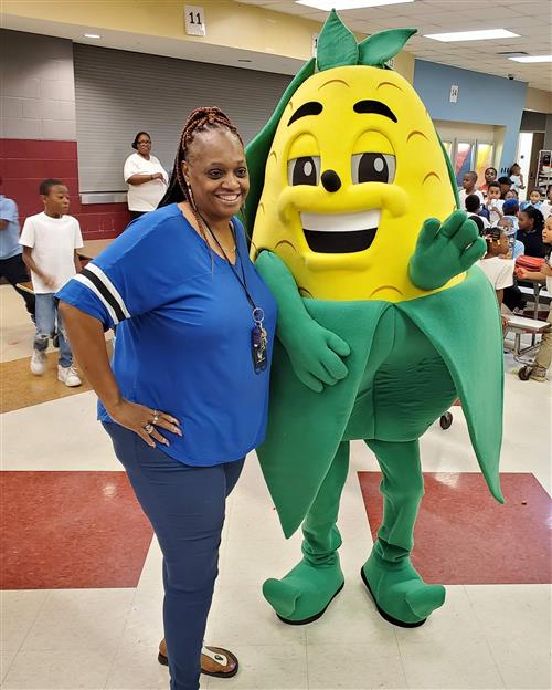 Grimes with Fall Harvest Festival Mascot