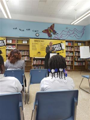 Dr. Vitti speaks at Mann during the Expect Respect kick-off press conference