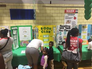 Mann parents sign students up for school clubs during open house