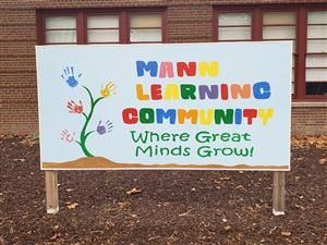 "Mann Learning Community ""Where Great Minds Grow"" sign"