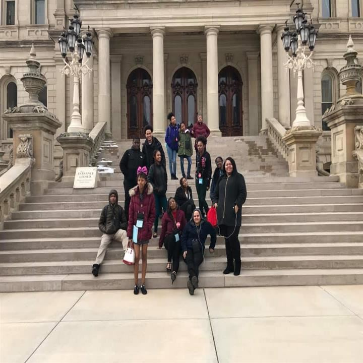 students pose for Picture on steps of State Capital