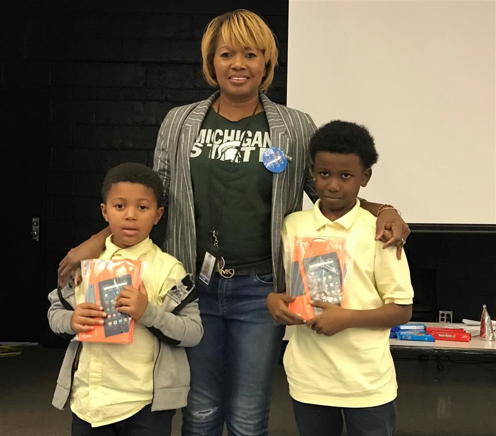 Principal with two students