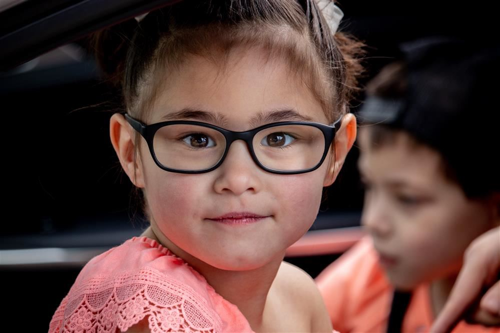 a girl wearing glasses
