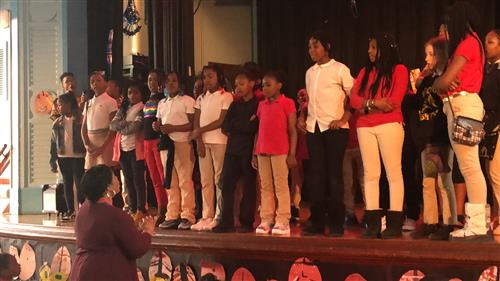 students on stage singing at African American History programs