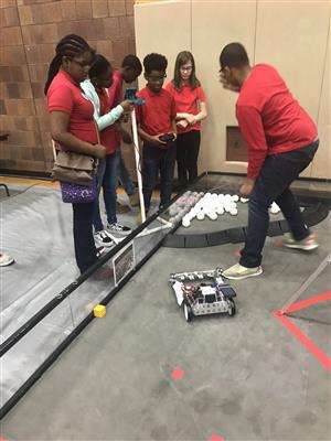 Students working with robot