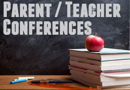 parent teacher conference stacked books and apple