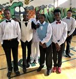 8th grade boys pose for a picture during their junior prom