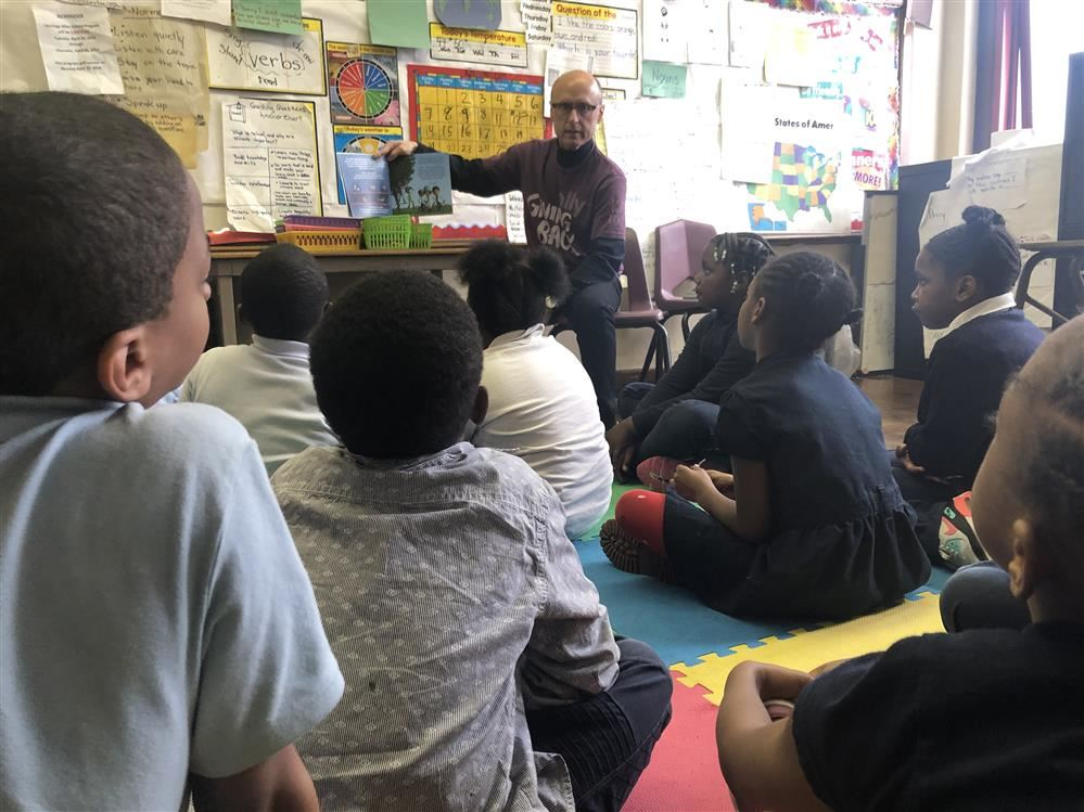 Ally bank representative reading to second graders