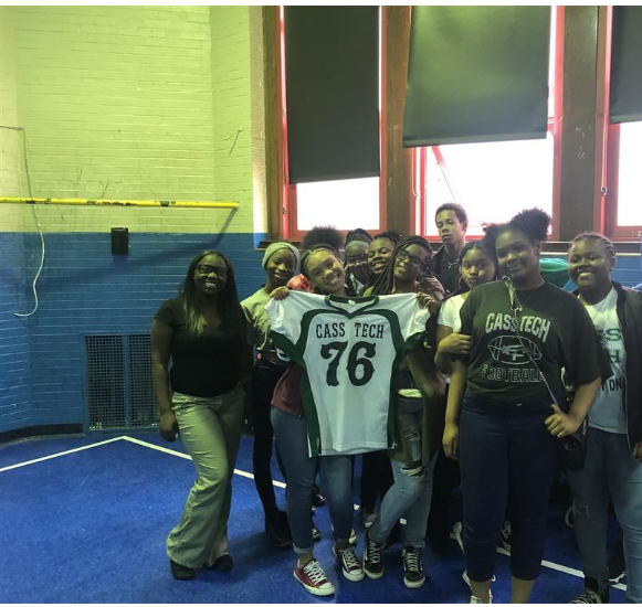 8th Graders posing with Cass Tech jersey