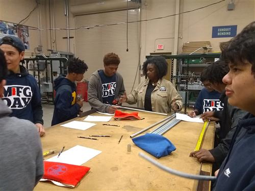 Manufacturing Day - Student Learning To Calculate Bend Radius