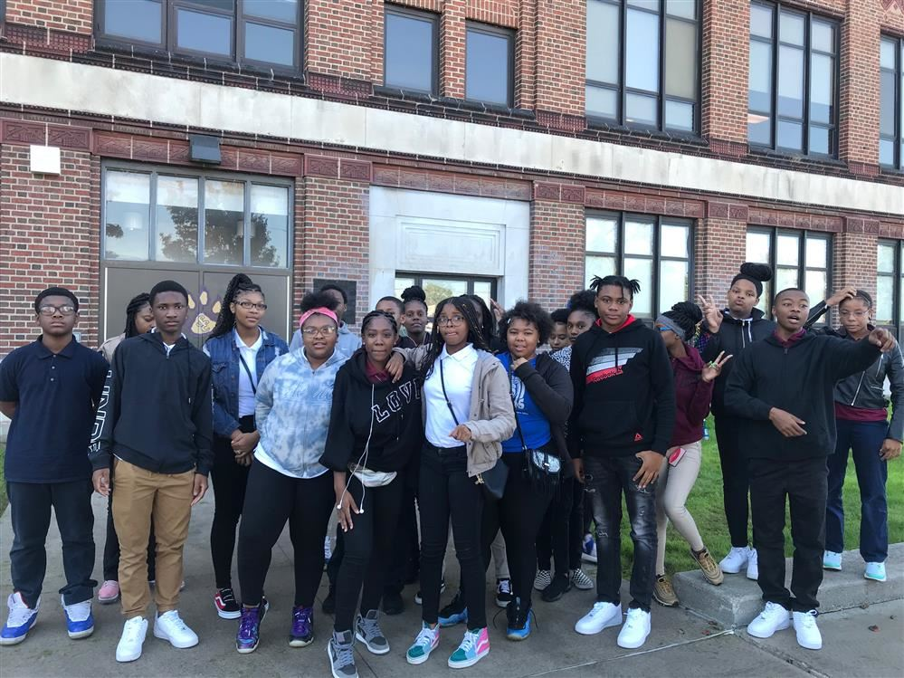 Eighth grade students stand in front of  Southeastern  High School