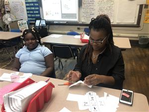 Ms. Fant and her daughter London learning about an ELA game.