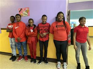 Ms Portis' 8th graders wear red