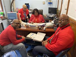 Principal Lee, Assistant Principal Carter, Dean Pilgrim and Ms. Reese, Secretary wear red .