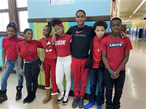 Mrs. Hawkins' grade 7 students wear red