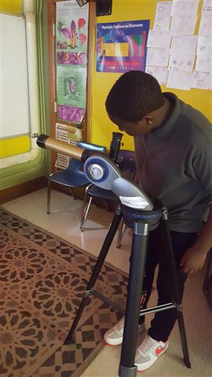 Student using the telescope to view the Mercury Transit