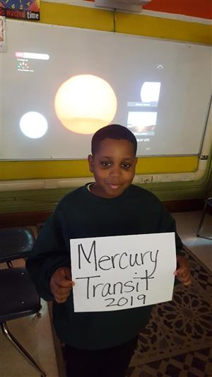 Student displaying information about Mercury Transit