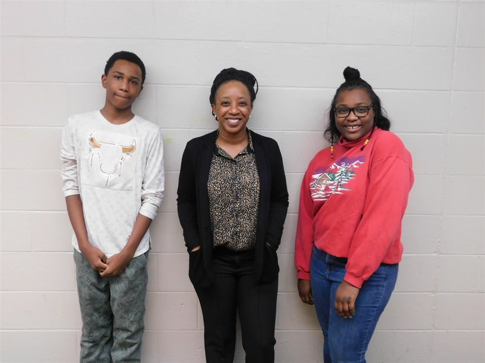 Pieter and LaShaun student Ambassadors for Positive Behavior Support and Dean of Culture Ms. Bussey
