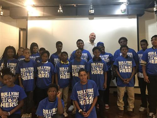 Students and staff in bullying tee shirts
