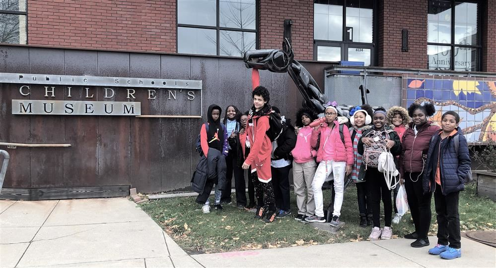 Picture of the students standing in front of the Children's Museum