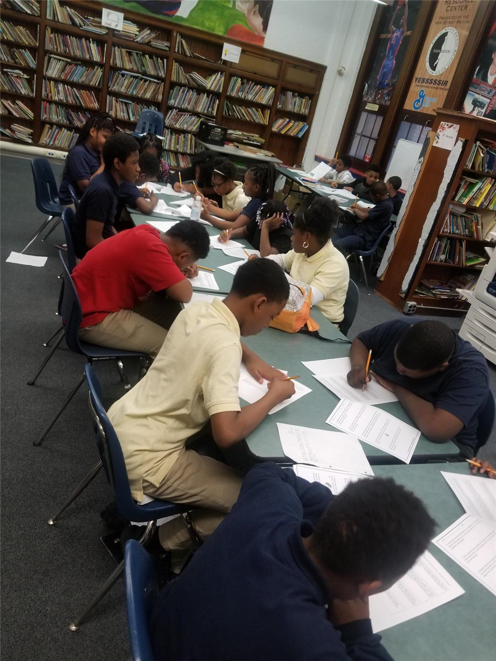 6th Grade students completing class work