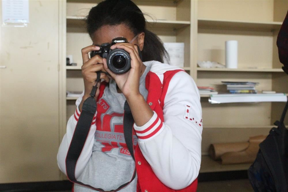 Image of student taking a picture with a camera