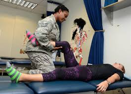 A picture of a woman stretching another woman's leg
