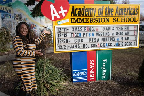 Mrs. Pettway in front of the sign