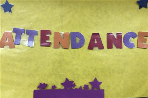 a sign with the word attendance
