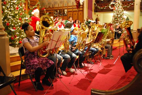 bethune students sitting front row with tubas for a Very Tuba Christmas