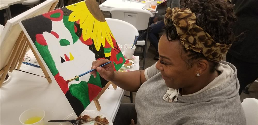 Adult Education West student Ryan Giles working on her masterpiece at Painting with a Purpose.