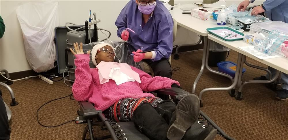Adult Education West student Antigone Williams getting a dental exam on Jan. 17.