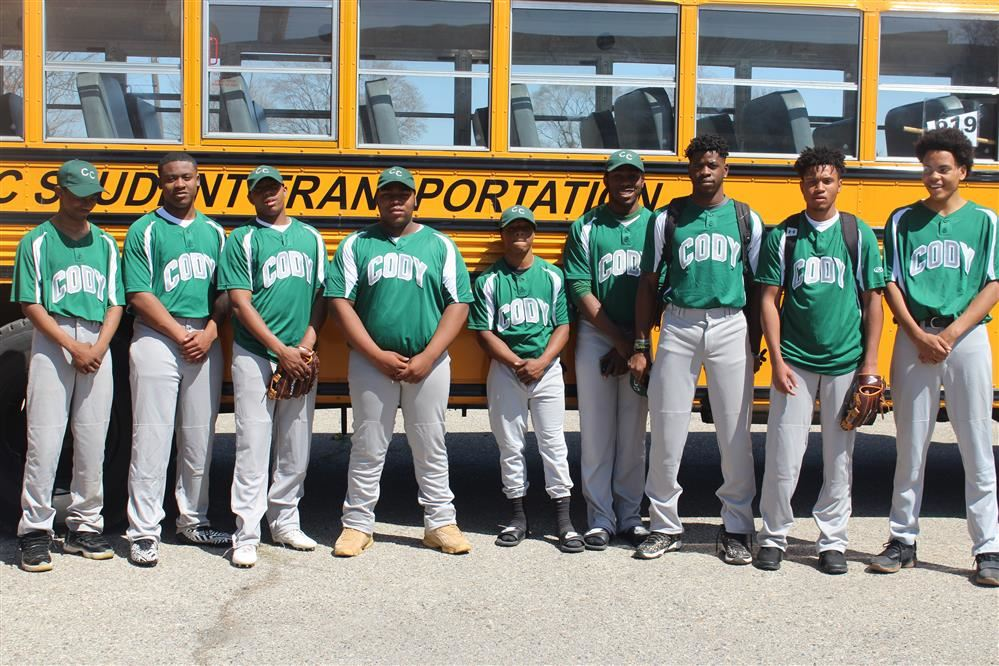 Boys baseball team poses before a game