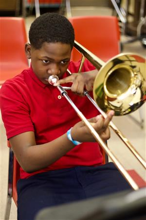 Student Playing a Trombone