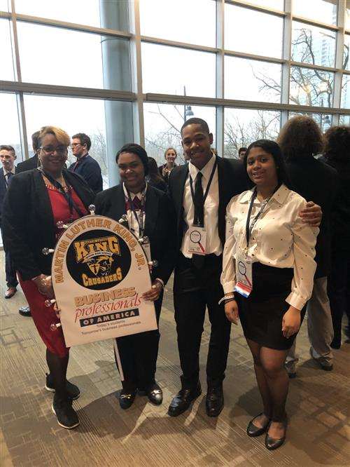 Business Professionals of America King Students at State Competition, holding King Crusader sign to represent school.