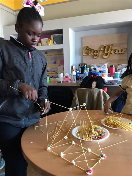 Student builds her bridge with spaghetti noodles and marshmellows