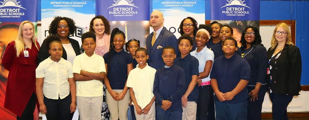 Dr Vitti with students at press conference