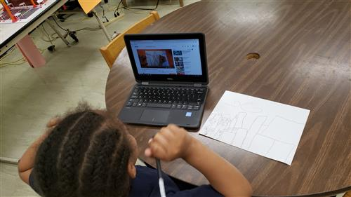 Student using computer for drawing