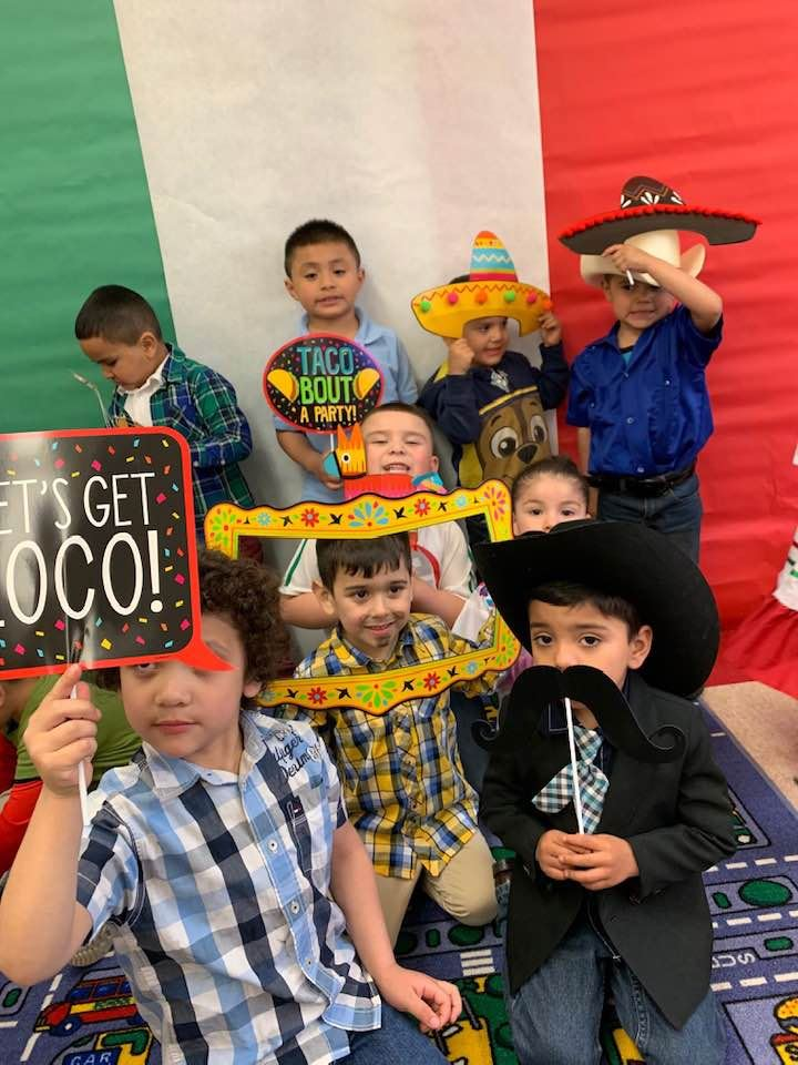 Several Pre-K students holding celebrating Cinco de Mayo