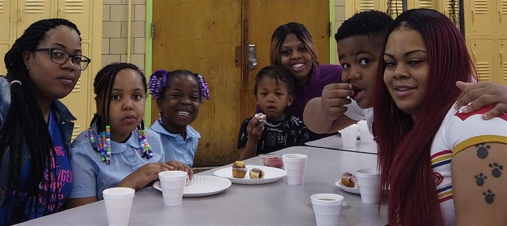 students eating muffins with moms