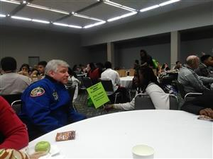 student talking to astronaut