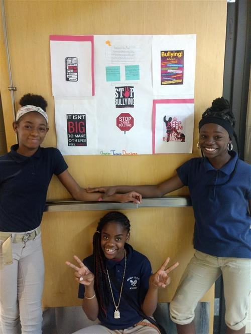 Seventh grade students pose with their anti-bullying project