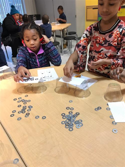 Students explore math and science concepts at the Hands On Science Museum