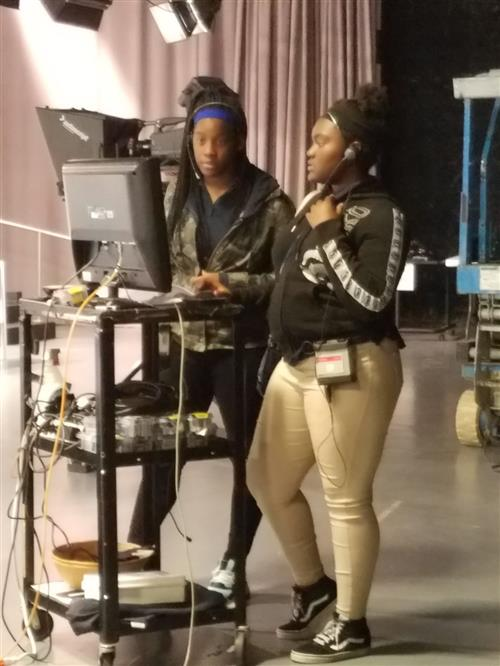 students work as a floor manager and camera operator at Detroit Television Studios
