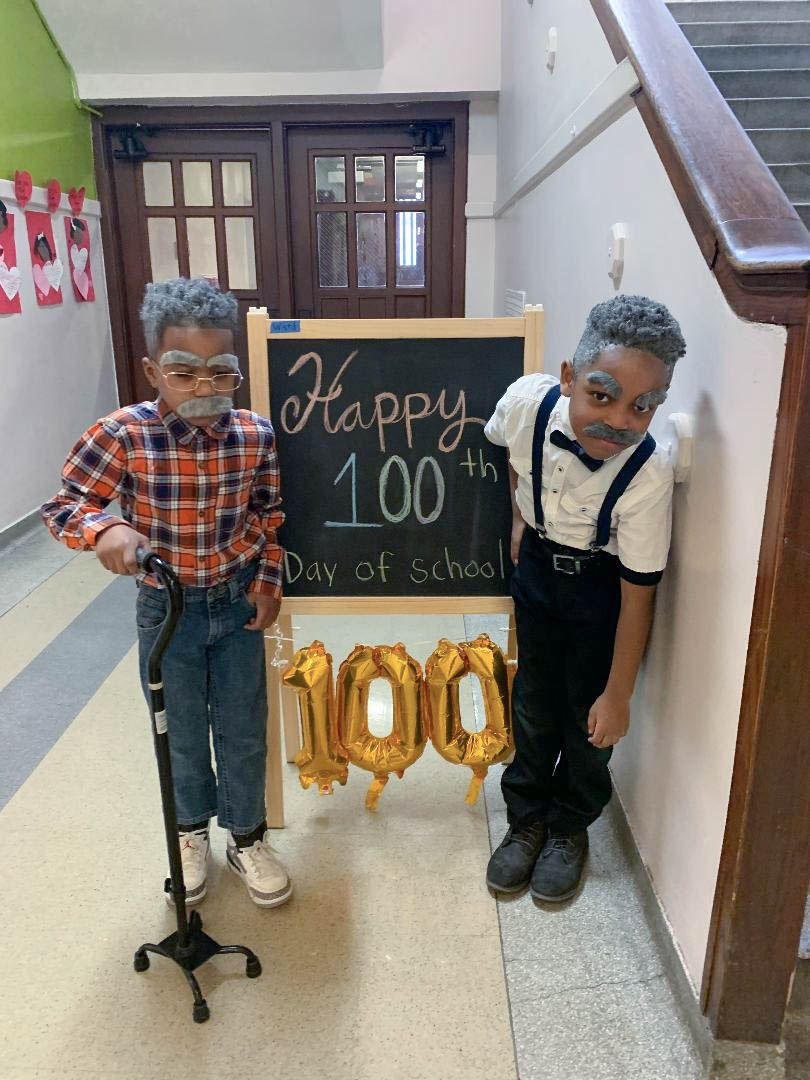 Image of two students celebrating 100th day of school