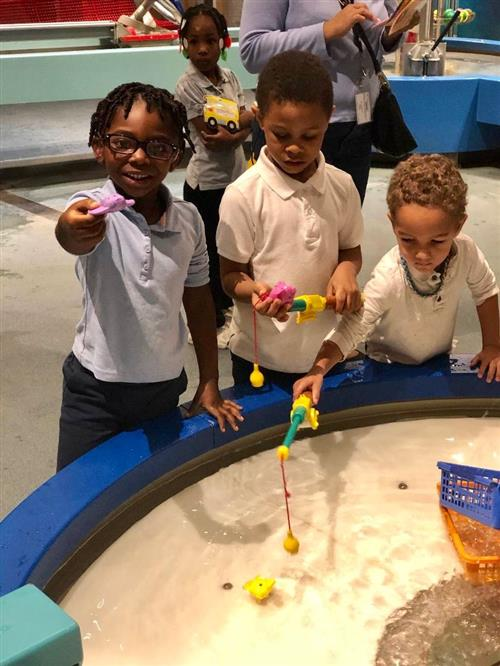 Students playing with Water Table