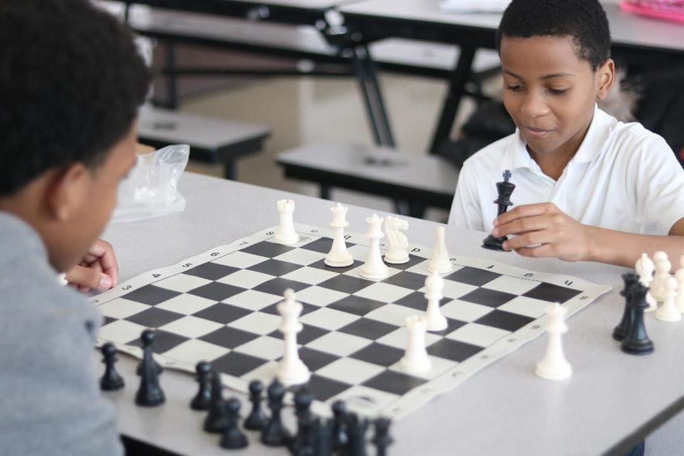 Students playng a gam of Chess