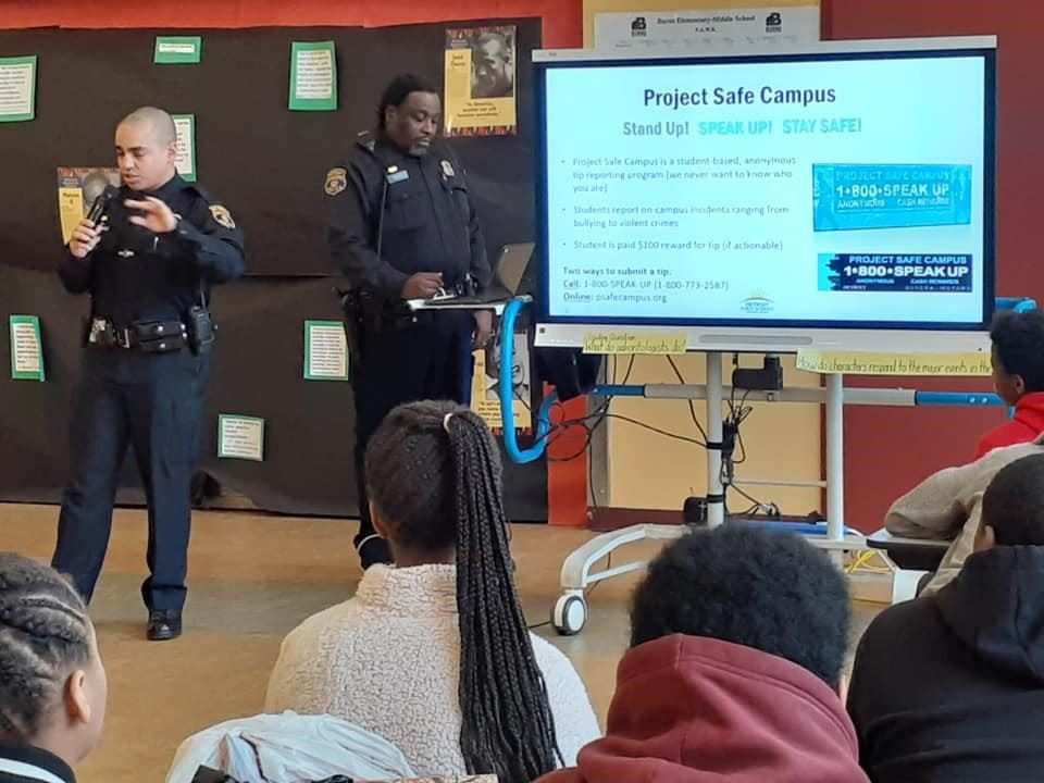 Local Police officers speaks with students