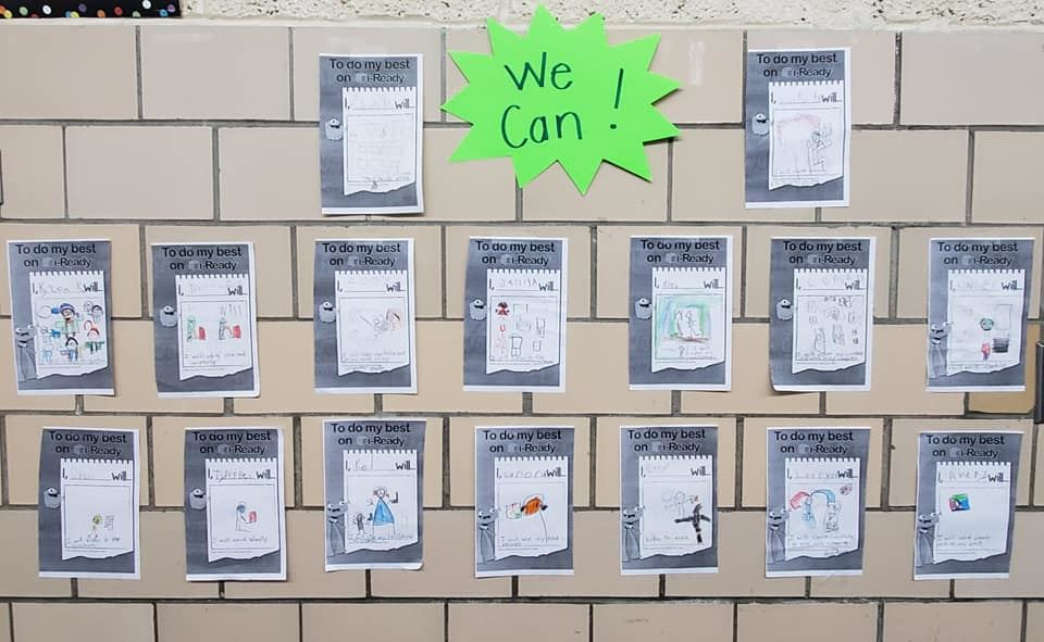 Kindergartners We Can data sheets displayed on wall